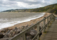 Charmouth beach in Dorset. It is located the mouth of the River Char overlooking Lyme Bay.  It is on the South West coastal path Royalty Free Stock Photos