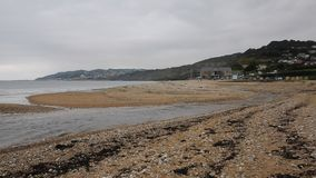 Charmouth beach Dorset England UK with pebbles and shingle and coastline stock footage