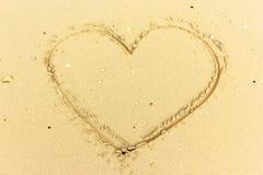 Charneca do texto na areia molhada Imagens de Stock