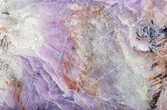 Charoite stone texture macro Royalty Free Stock Photos