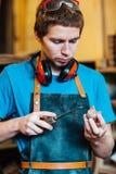 Charpentier Making Wooden Toys photo libre de droits