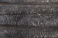 Charred black wooden wall Stock Photo