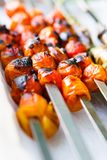 Charred Cherry tomatos. Grill charred cherry tomatos on metal skewers Stock Photography