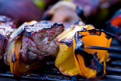Charred Kebobs. Shish Kebabs almost ready to eat on grill stock photos