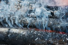Fire, smoke and coals Royalty Free Stock Photo