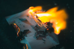 A charred piece of paper on a dark background Iron Royalty Free Stock Image
