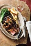Charred steak with mushroom vinaigrette Stock Photo