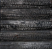 Charred wooden house wall Royalty Free Stock Photography