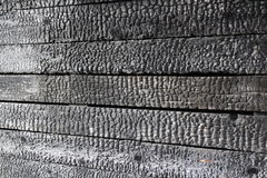Charred wooden wall after fire arson Stock Photo