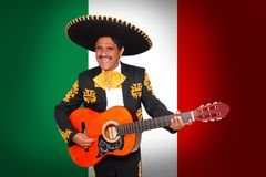 Free Charro Mariachi Playing Guitar In Mexico Flag Stock Photography - 19163362