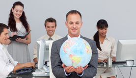 Charsmatic manager smiling at global expansion Stock Photography