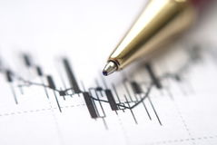 Chart. Exchange rates review with pen Royalty Free Stock Images