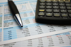 Chart analyzis. In an office with pen and calculator Royalty Free Stock Photography