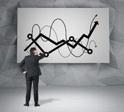 Chart and arrow on desk Royalty Free Stock Photography