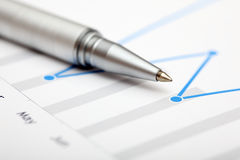 Chart with ballpoint pen Stock Image