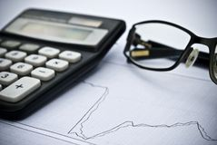 Chart, calculator, glasses as financial stock analysis concept Stock Images