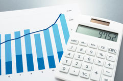 Chart and calculator on gray reflection background. Stock Image
