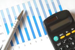 Chart with calculator and pen Royalty Free Stock Photos