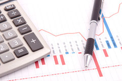 Chart, calculator and pen Stock Images