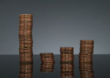 Chart of coins stacks on dark gray background with reflection Royalty Free Stock Image