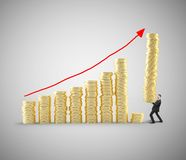 Chart coins. Young man with tower of coins building chart coins Stock Photos