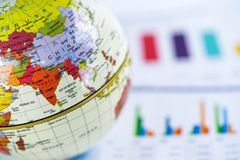 Chart graph paper with globe world Asia map on . Finance, Account, Statistics, Investment, Analytic research data economy. Chart graph paper with globe world stock photo