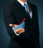 Chart of growth. Man holds the chart of growth Royalty Free Stock Image