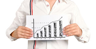 Chart of growth. Businessman holding a chart of growth Royalty Free Stock Photos