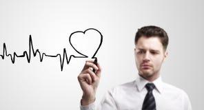 Chart heartbeat. Business man drawing chart heartbeat stock photography
