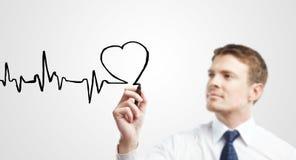 Chart heartbeat. Business man drawing chart heartbeat stock photo
