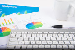 Chart and keyboard. Keyboard on desk with financial chart stock photos
