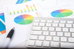 Chart and keyboard. Keyboard on desk with financial chart royalty free stock photo