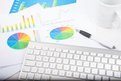 Chart and keyboard. Keyboard on desk with financial chart stock photo