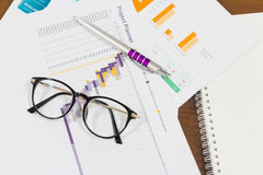 Chart and paperwork on office table Stock Photos