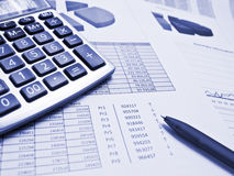Chart with pen and calculator. Blue toned chart with pen and calculator Royalty Free Stock Photography