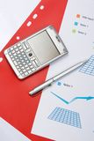 Chart with a pen and mobile. Closeup of a chart with a pen and mobile Royalty Free Stock Image