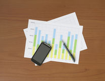 Chart, Pen and Smart Phone on the Worktable Royalty Free Stock Photo
