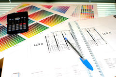 Chart and plans. Colour chart, ruler, pen, calculator and plans...  on a desk ready to be studied Stock Image