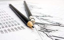 Chart and two pencil Stock Images