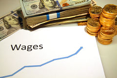 Chart of wages rising up with money and gold Royalty Free Stock Image