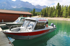 Charted fishing boats at Lake Minnewanka in Banff National Park Royalty Free Stock Photography
