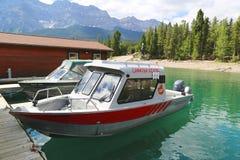 Charted fishing boats at Lake Minnewanka in Banff National Park Royalty Free Stock Photography