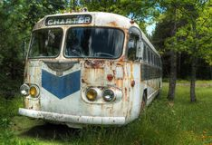 Charter Bus to Nowhere. Abandoned old bus stock image