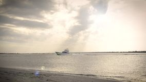 Charter Fishing Boat Heading Out to Sea. A charter fishing boat heads through an inlet, and out to sea stock footage