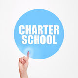 Charter school concept. Hand pushing virtual button of internet page to get informed about studies stock photography