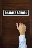 Charter school concept. Male hand knocking on the door royalty free stock photos