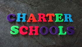 Charter school concept. Charter Schools spelled out in colorful play letters -- education concept stock image