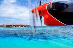 Charter to exotic resort. Little airplane flying to exotic country, luxury travel, summer vacation and holidays concept royalty free stock images