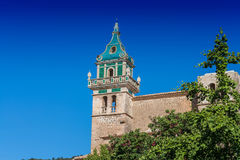 Charterhouse of Valldemossa on Mallorca, Spain. Beautiful view. Tower of the Monastery of Valldemossa in the Sierra de Tramuntana Mountains with park Stock Photography