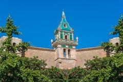 Charterhouse of Valldemossa on Mallorca, Spain. Beautiful view. Tower of the Monastery of Valldemossa in the Sierra de Tramuntana Mountains with park Stock Photos